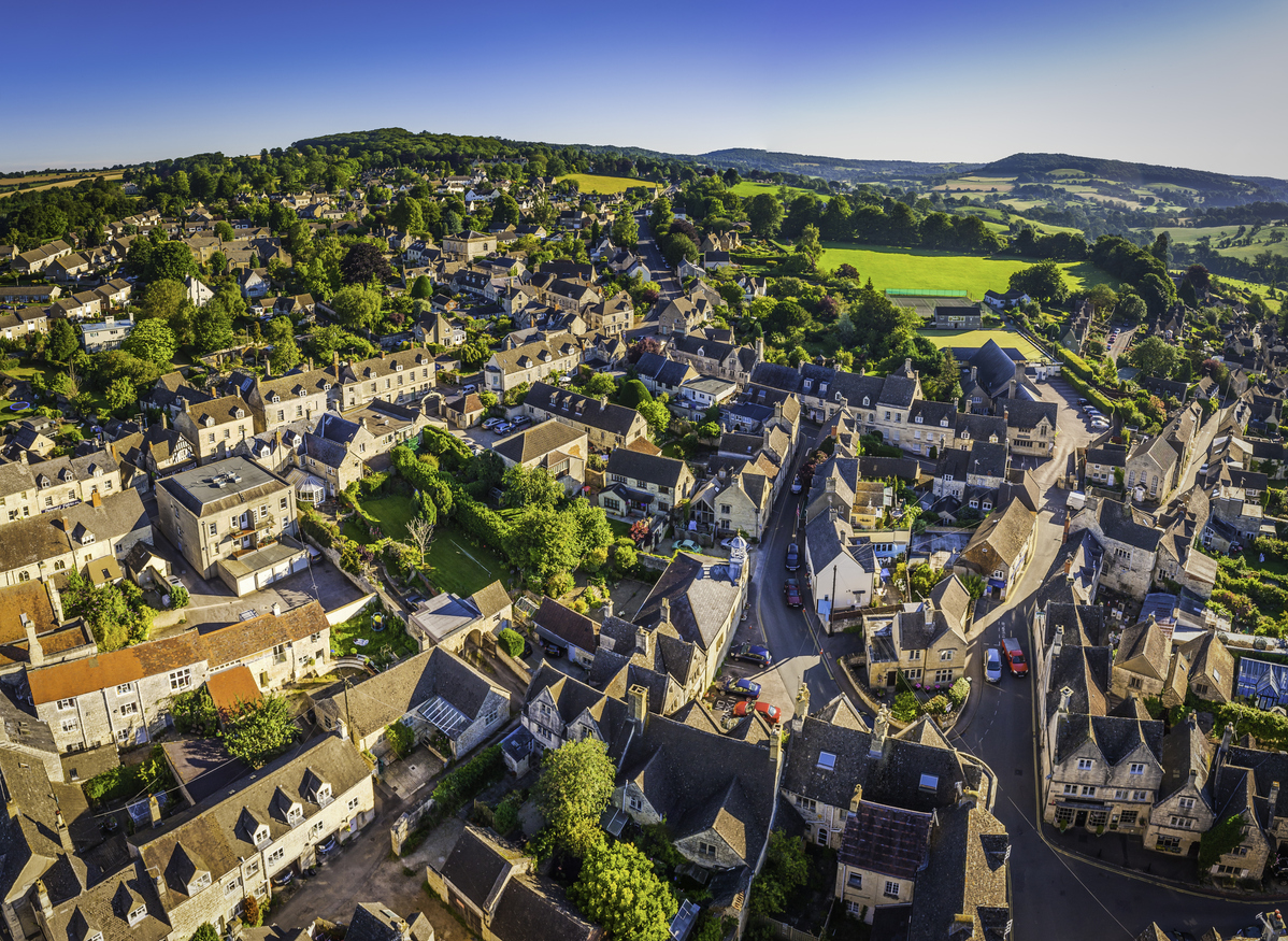Aerial view over a pretty rural village in Cotswolds