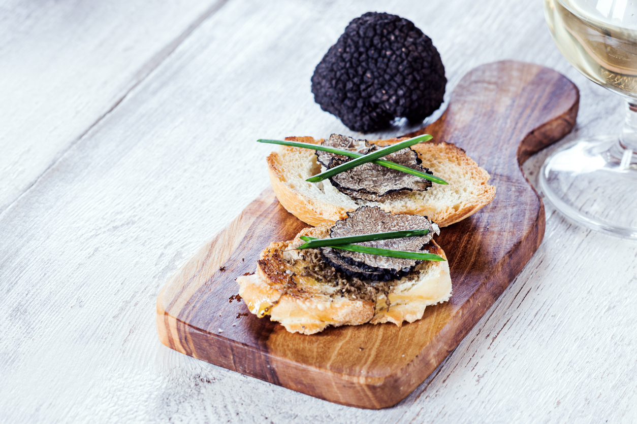 Italian black truffle bruschetta with herbs and oil on grilled or toasted crusty ciabatta bread