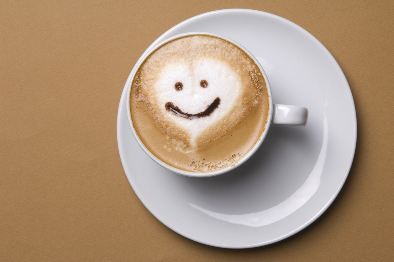 Cup of cappuccino with smiley face